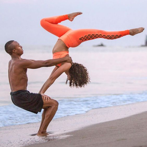 If you're looking for one of the most fun couple yoga poses around, this is the one for you.